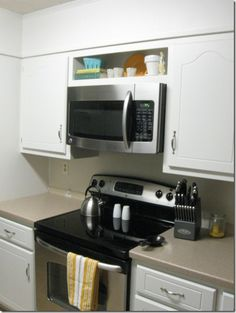 Hang an over the range microwave without an overhead for Best brand of paint for kitchen cabinets with papiers scrap