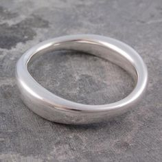 Graduated Chunky Silver Bangle - This gorgeous best-selling, Graduated Chunky Silver Bangle is created with electroforming allowing it to taper and creating an elegant, flowing and lustrous finish. #Otisjaxon #Jewellery #Bangle