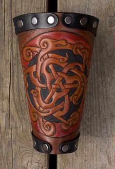 Viking vambrace Dragon Circle made of leather by Wodenswolf, Leather Bracers, Leather Tooling, Blacksmithing Knives, Leather Stamps, Cosplay, Fantasy Costumes, Fantasy Armor, Cowboy And Cowgirl, Leather Projects