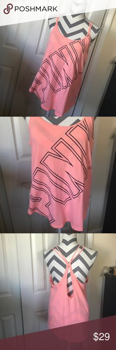🖤PINK TANK🖤 Coral orange peach color with open black lined block Lettered PINK covering the entire front of this really cute strappy tank! Has been worn a few times but is in excellent condition!!!! Size medium! BUNDLE AND SAVE 😘💖👍 PINK Victoria's Secret Tops Tank Tops