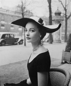 Diamonds, a little black dress, and a fabulous hat...Perfection!