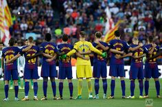 Spain Attacks Photo Gallery Barcelona players stand for a minute of silence for the victims of the van attack on Barcelona's Las Ramblas, before a La Liga soccer match between Barcelona and Betis at the Camp Nou stadium in Barcelona, Spain, on Aug. 20, 2017. (AP Photo/Manu Fernandez)