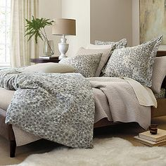Soft gray circles and white on duvet cover. Soothing but rather modern