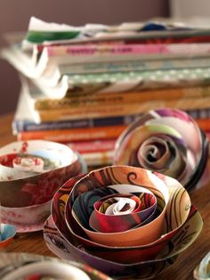 Flowers from old magazines. I have hundreds to toss, so why not make these?