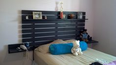 Headboard with floating side tables and shelf for a teen's bedroom.