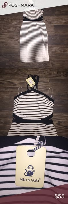 Peppermayo stripped dress size 12 Australia size Black and white striped fitted dress has some cutouts on the side. peppermayo Dresses Midi