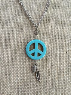 Turquiose peace sign pendant, feather charm, Buddha charm, metal chain by NaturallyPeaceful on Etsy