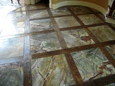 GORGEOUS rainforest marble floors. Wood inbetween.  So want to do in my next house