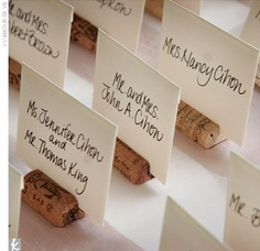 Place cards...on wine corks...and where are the opened bottles,you may ask? At your party.  ;P
