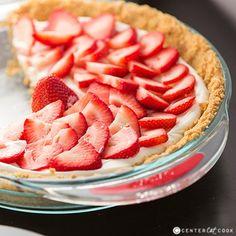 Strawberries and Cream Pie! Heavenly Strawberries and Cream Pie with fresh strawberries atop a sweet light and fluffy filling! Easy to make, this Strawberry Pie is going to quickly become a family favorite!