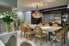Sala de jantar e cozinha integradas, luxuosas e decoradas na cor preta!