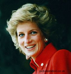 October 09, 1989: Princess Diana on a visit to RAF Wittering. A photo from this event was used on the cover of You magazine. Diana wearing a red military style suit and her large gold and stud earrings.