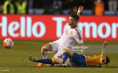 Morgan Schneiderlin of Manchester United in action with Andy Mangan of Shrewsbury Town during the Emirates FA Cup Fifth Round match between Shrewsbury Town and Manchester United at Greenhous Meadow on February 22, 2016 in Shrewsbury, England.