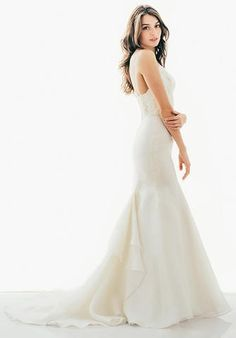 Judd Waddell Lucia is a sweetheart fit and flare gown. It features a draped bodice with spaghetti straps and Alencon midriff over a fit and flare Skirt. This gown came from a designer bridal boutique and is in excellent condition. Judd Waddell Lucia is Ivory and a size 10.