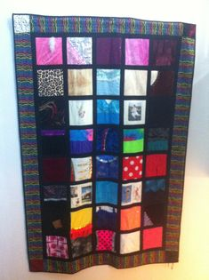 Quilt made from dance costumes collected over the last 18 years.