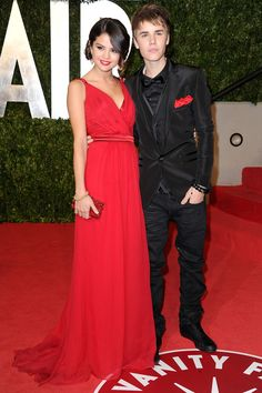 """Now here's where things get good. The teen stars made their official public debut as a couple on Oscar night 2011. They walked the red carpet at the Academy Awards after party in these striking outfits, letting everyone in the world know what they already knew: """"We're dating."""""""