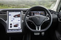 The very smart touch screen and interior of the Tesla Model S. - LGMSports.com