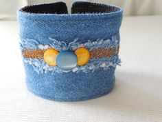 This medium blue denim cuff is a great bracelet for someone with a larger wrist. It will fit more like a bangle on smaller wrists. One size does fit all with this bracelet. Denim is a very versatile fabric and will co-ordinate with any denim or snappy casual outfit. This bracelet