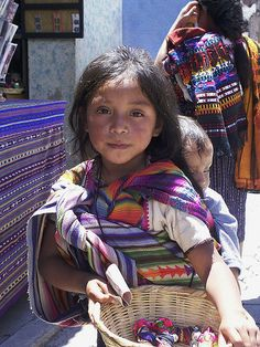 Maya girl selling worry dolls at the Chichicastenango market, Guatemala by wabs, flickr  #world #cultures