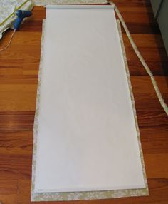 Glue fabric to Wal-Mart roller blind! Smart! OH my word...how did I not think of this! - must do for the basement door!!!