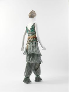 Early in the twentieth century Diaghilev's Russian dance company, Ballets Russes, performed in Paris—reigniting the taste for orientalism in Europe with its exotic sets and costumes. As this ensemble illustrates, Poiret excelled in recontextualizing western dress with fantastical eastern influence. He was also a maverick modernist in creating a stir, taking promotion of his inventive ensembles to new levels with his infamous spectaculars.