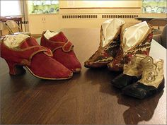Red wedding slippers of Abigail Fairbanks from 1747, a pair of carriage boots from 1859, and toddler shoes from the late 19th century. Fairbanks was a member of a prominent Dedham family at the time. The Fairbanks home , 511 East St., is a historical site as the oldest timber-frame home.