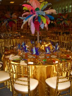 Why use flower centerpieces all of the time? Feathers give a fun, colorful, party atmosphere!