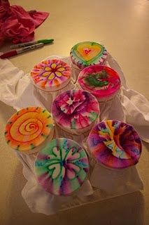 Tie dying using permanent markers and rubbing alcohol. Very neat.    And for you first time dyers: She notes that heat setting is the key... I have found that leaving the shirt in the car on a hot day works wonders. That's why I always tie dye in the summer.