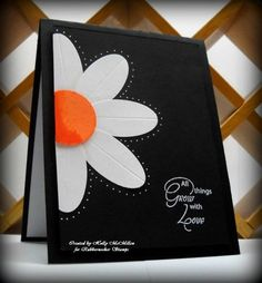 handmade card ... white on black with a pop of orange ... luv the huge paper pieced daisy going off the side ...