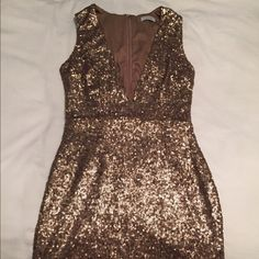 Gold Sequin Mini Dress This gold sequin mini dress is perfect for themed parties like a disco or great gatsby! You'll have heads turning in this statement piece. Brand new, never worn - it was way too short for me. Tobi Dresses Mini