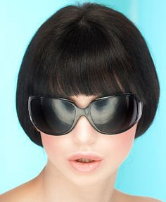 Smooth rounded short hairstyle.