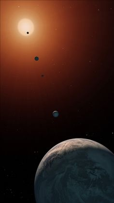 TRAPPIST-1 is Older Than Our Solar System. Above: this illustration shows what the TRAPPIST-1 system might look like from a vantage point near planet TRAPPIST-1f (at bottom). Image Credit: NASA/JPL-Caltech