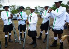Shembe church dancers with garb influenced by the Scottish regiment: kilts, pith helmets