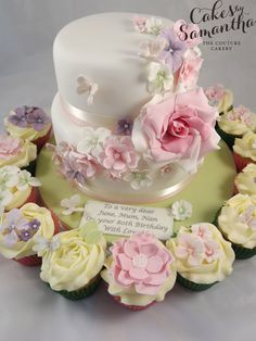 2 tier Birthday Cake with a cascade of handmade sugar craft flowers.