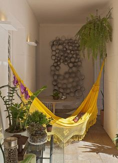 Hammock. Balconies are great for outdoor decor projects. You can get a modern, retro, mid-century or even eclectic balcony mood. Use chairs, tables, floor lamps... Be creative and find more good home design ideas here: http://www.pinterest.com/homedsgnideas/