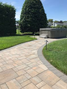 Cambridge Pavingstones with ArmorTec offers pavings options for patios, pools, walkways, driveways, landscape walls and outdoor living solutions. Paver Sidewalk, Driveway Design, Paving Stones, Outdoor Projects, Long Island, Cambridge, Paths, Outdoor Living, Backyard