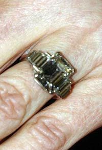 The Duchess of Cornwall's ring Charles' grandfather, Prince Albert (the future George VI) was so overjoyed when his wife gave birth to their first daughter, he gave her this emerald-cut diamond with 3 diamond baguettes along each side.