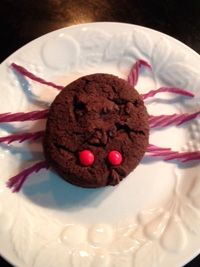 Creepy Spider Cookies  1 package chocolate fudge cake mix 1/2 cup butter, melted 1 egg 1 can chocolate frosting Shoestring black licorice, cut into 1 & 1/2 inch pieces 1/4 cup red hot candies or mini M&M's  Click here for the complete recipe: http://www.q99fm.com/BreakfastClub/FDT2014.aspx