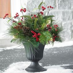 Lifelike pine, berries and pinecones come together in this festive urn arrangement for pure winter beauty. Pre-lit with 50 LED lights and a timer Outdoor Christmas Planters, Christmas Urns, Outdoor Christmas Decorations, Simple Christmas, Winter Christmas, Christmas Lights, Christmas Wreaths, Christmas Crafts, Holiday Decor