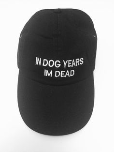 IN DOG YEARS IM DEAD. 6 panel unstructured cap. Fabric closure and brass buckle. 100% cotton.