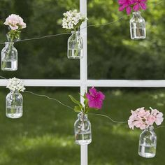 Strung on a wire, this garland of tiny bottle bud vases is a festive accent when you insert a single flower into each. 12 per garland. Mini Milk Bottles, Small Bottles, Small Vases, Milk Jars, Vase Transparent, Holding Flowers, Bottle Vase, Flower Garlands, Dot And Bo