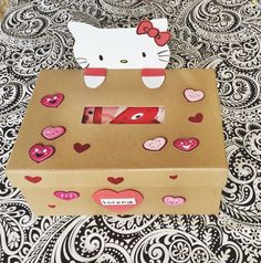Hello Kitty Valentine Mailbox Using foam craft, draw, cut and glue Hello Kitty's head and arms to a box. Fun and easy to do!  #valentine #mailbox #HelloKitty #ValentinesDay