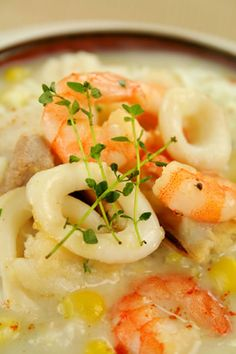 This flavorful chowder recipe combines crab, clams, calamari, scallops, and shrimp with mushrooms soup, milk, cream cheese, and vegetables for a rich and hearty flavor. Parsley, garlic and cayenne pepper are used to add even more taste, and this wonderful chowder is easy to make and enjoyable to eat. You can use low fat cream cheese, milk and soup if you are watching your waistline, or just use regular ones if not.