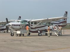 Fly from Belize airport to Caye Caulker rather than taking the water taxi. More expensive although only takes 30 minutes. The walk taxi takes 1 hour and 30 minutes. You'll also see some wonderful blue water from the sky which is a joy from the dazzling lights of London.  https://www.tropicair.com/w1/