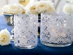 Scrapbook paper, clear votives and tape make for an easy #DIYWedding craft. Get more ideas from Decor Anyone Can Make >> http://www.hgtv.com/design/make-and-celebrate/entertaining/diy-wedding-decor-anyone-can-make-pictures?soc=pinterest