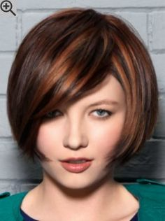 Mouth length bob cut with sleek styling and diagonal bangs. Brown hair with copper highlights.
