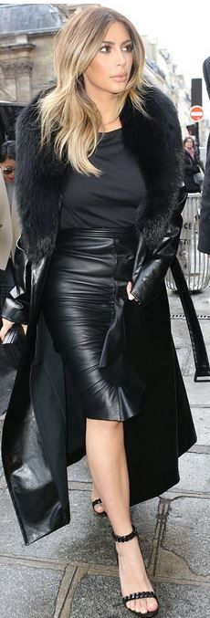 Who made  Kim Kardashian's leather coat, black top, chain sandals, and ruched ruffle skirt?
