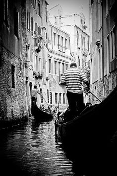 Ride a gondola while visiting Italy