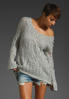 I love this whole picture, short sassy hair, off the shoulder sweater with cut off jeans...SO ME!