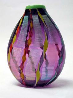 """Amethyst Dichroic Vase"" art glass vase created by artists Ingrid & Ken Hanson. Radiant Orchid"